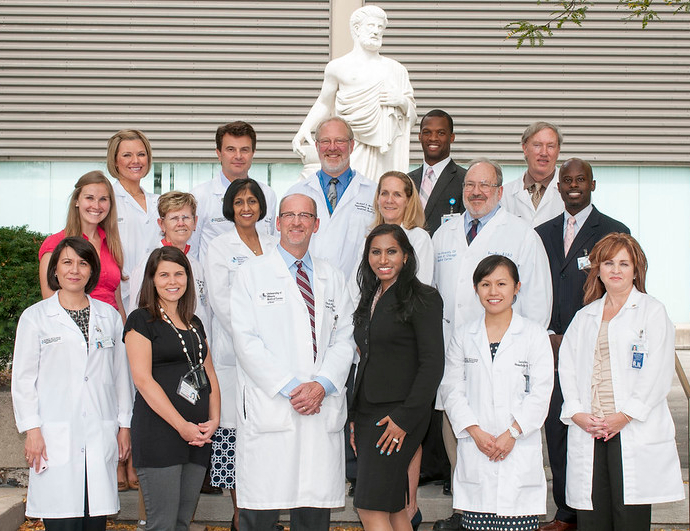 University Of Illinois Breast Cancer Doctors Team with white statue behind them.