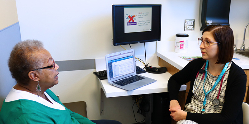 Patient Verna Rose talking with Dr. Deborah Manst about how communication is important for a successful cancer treatment.