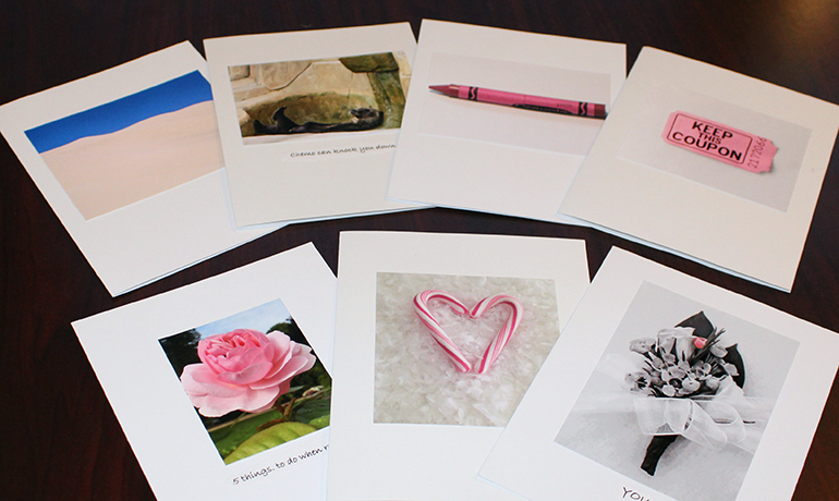 Different white cards with hearts and flowers on them.