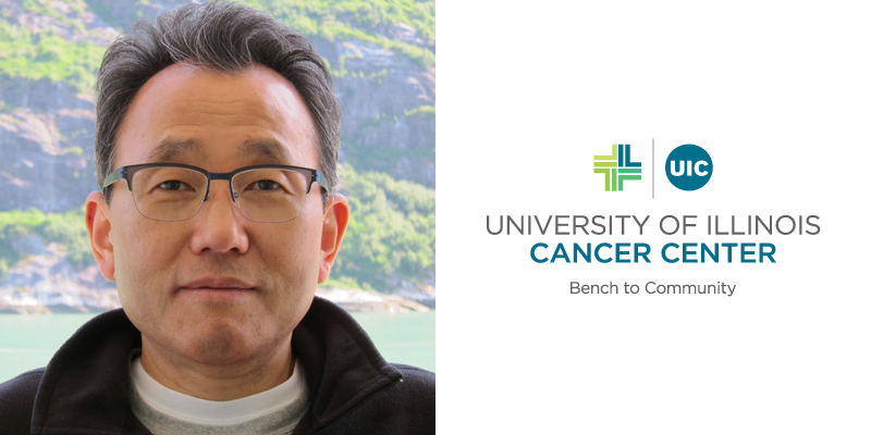 Wonhwa Cho, UIC professor and head of the department of chemistry, is welcomed to the UI Cancer Center.