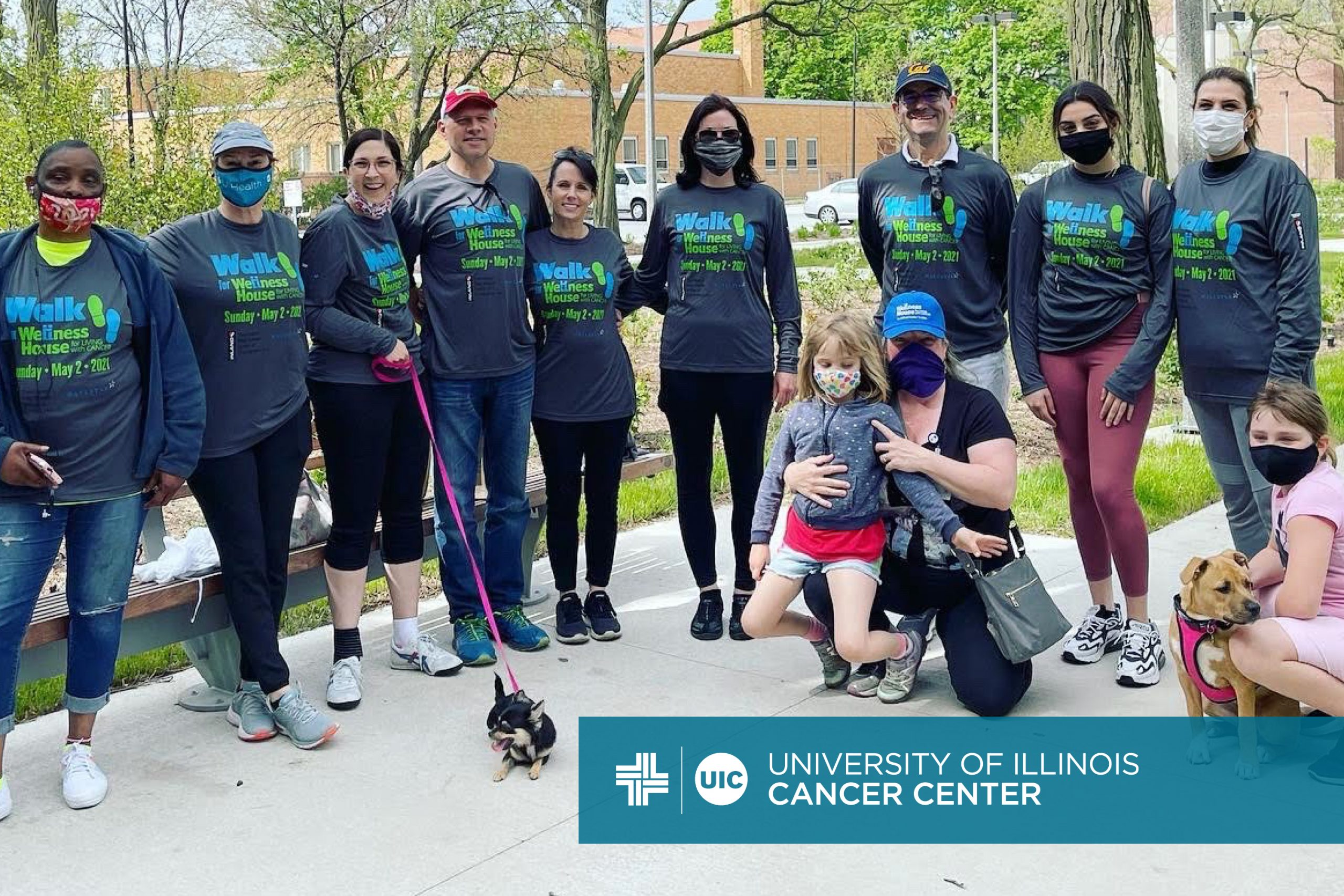 Photo of the Walk for Wellness House team and the University of Illinois Cancer Center logo